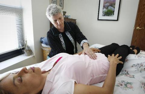 Sister Madeline Gianforte with a client at CORE/El Centro, a center for holiistic healing.